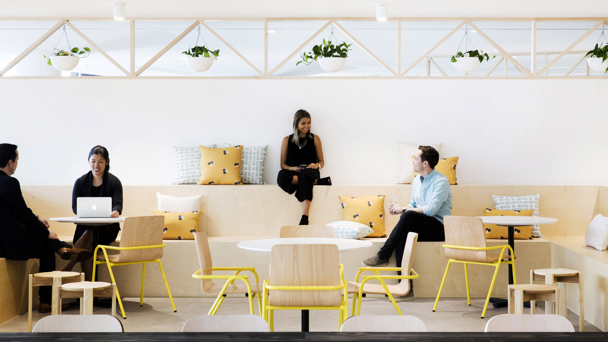Employees sitting in a communal lounge space at the Yahoo7 offices in Sydney, Australia.