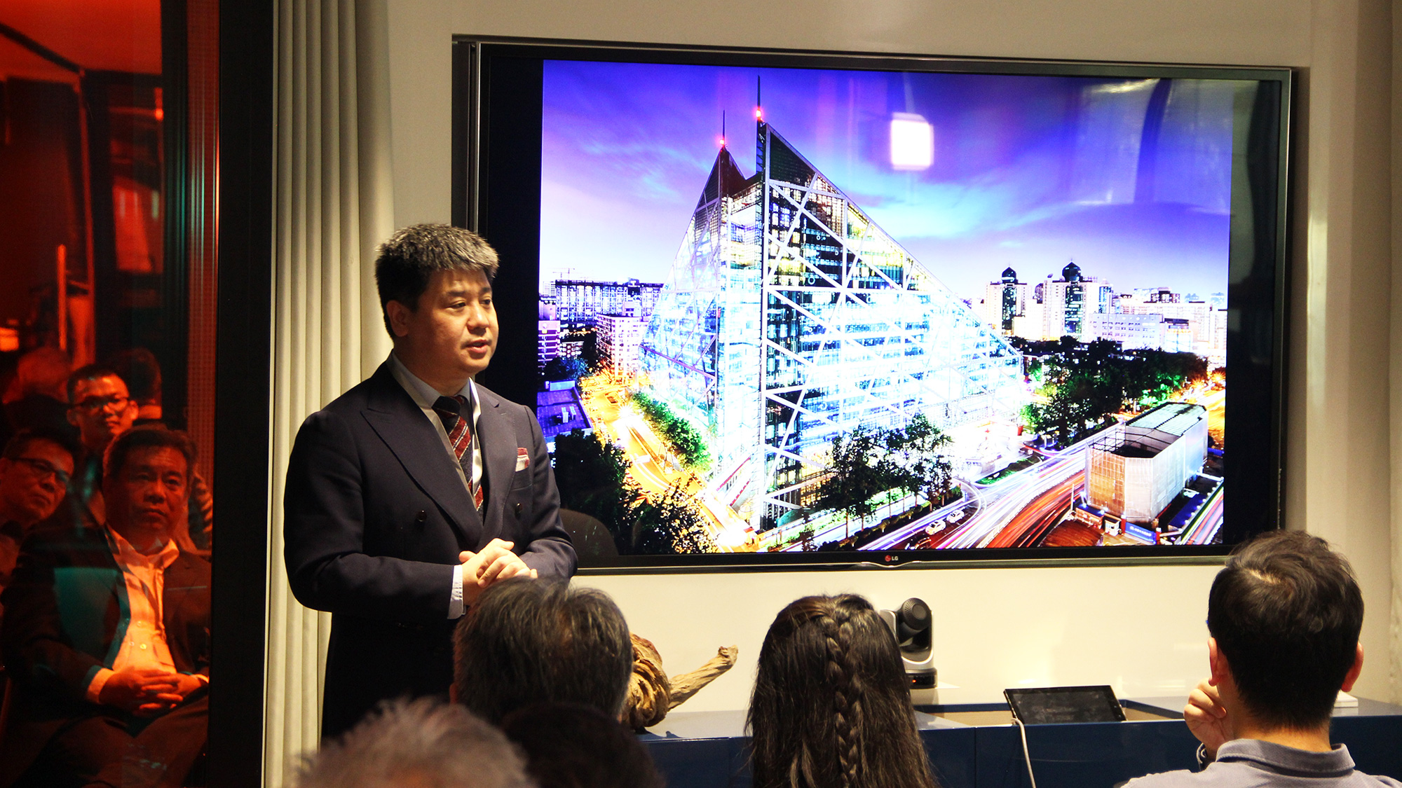 A panelist discusses the sustainable design for the Parkview Green Complex in China