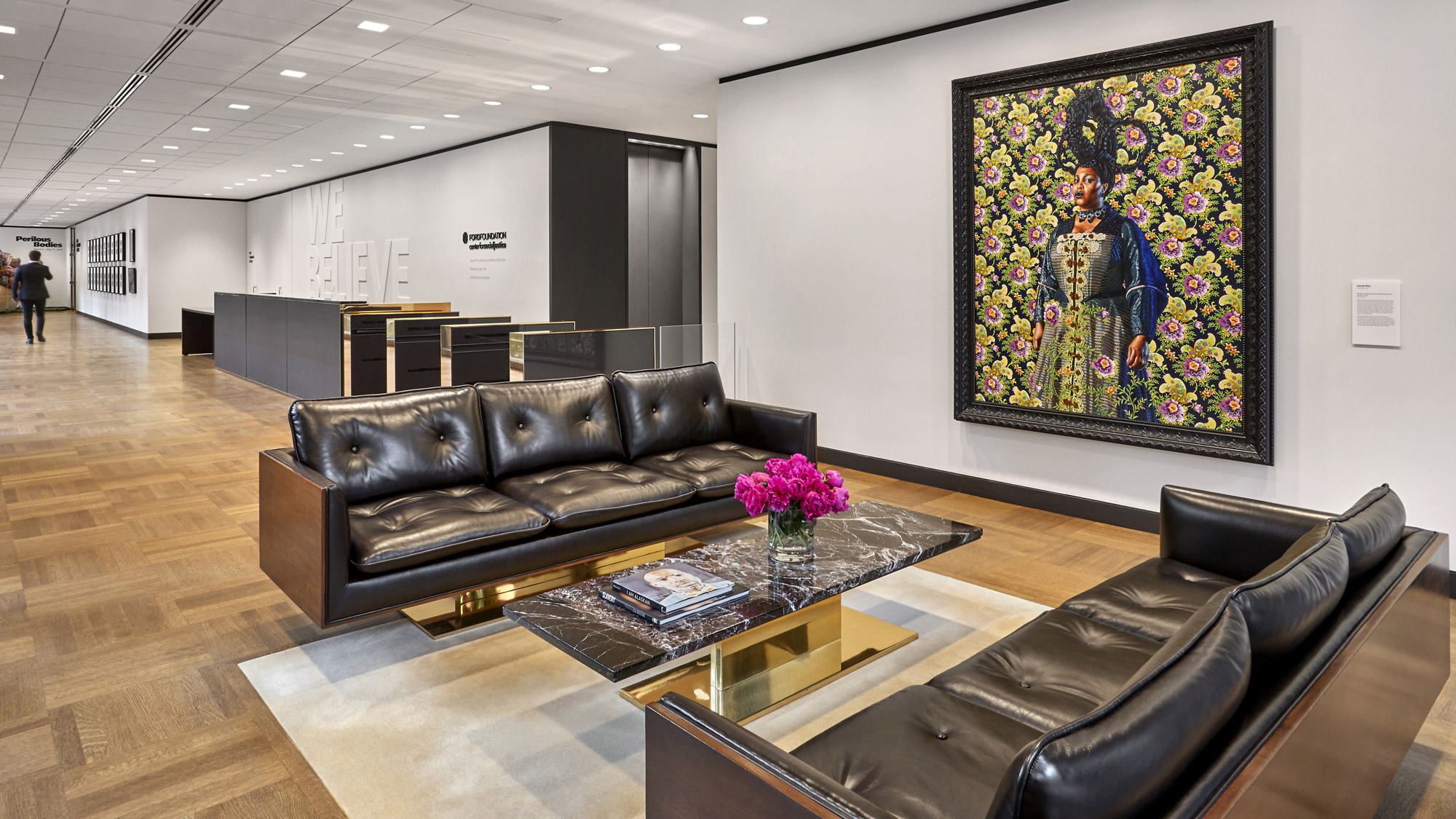 A vibrant painting by Kehinde Wiley overlooks the reception area of the Ford Foundation for Social Justice.